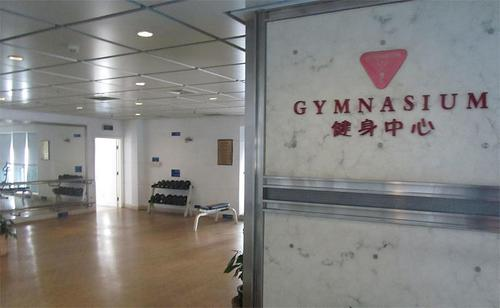 Gym with free weights at International Service Apartments