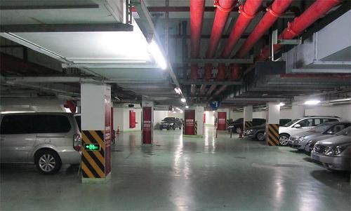 Parking garage with 8 parked cars at International Service Apartments