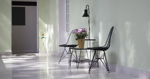 Coffee table with flower vase and two chairs