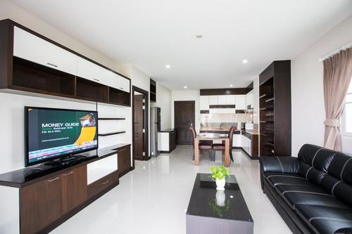 Spacious open living room with a kitchen, and a dining table