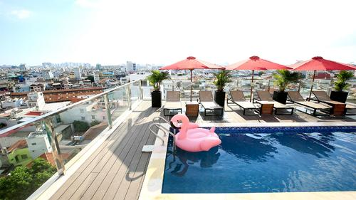 Rooftop swimming pool with a stunning view of Ho Chi Minh City skyline