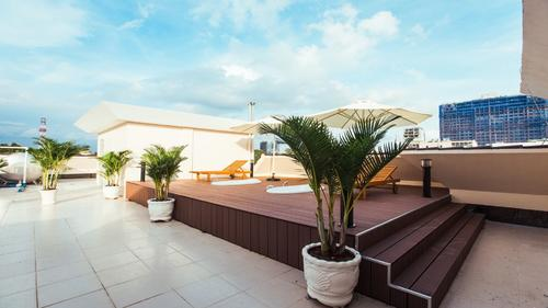 The rooftop offers a place to relax and a view of Ho Chi Minh City