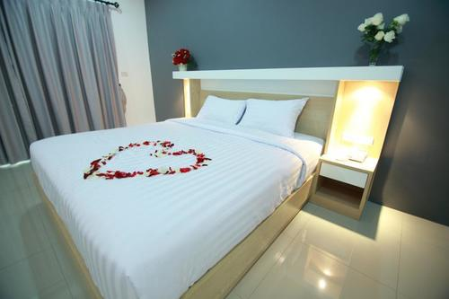 Comfortable bed covered in roses