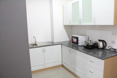 Kitchen with microwave, elective stove and kettle