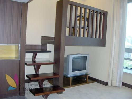 Stairs to workspace with desk and comfortable chair