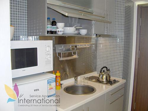 Kitchen with kettle, microwave, and utensils