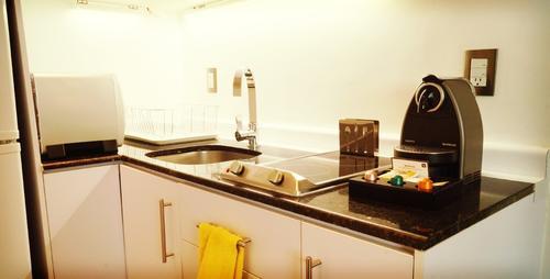 Kitchen with fridge, freezer, and coffee machine
