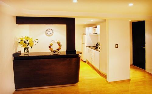 Kitchen with microwave, fridge, freezer, coffee machine, and flower