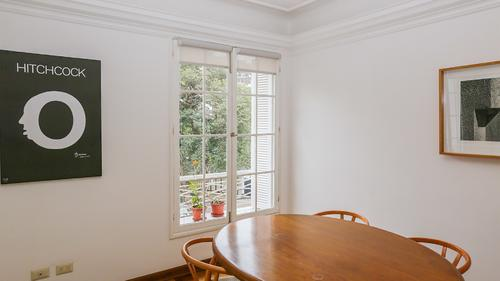 Large dining table by the window with 4 chairs