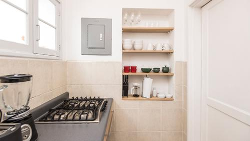 Kitchenette with utensils and pots