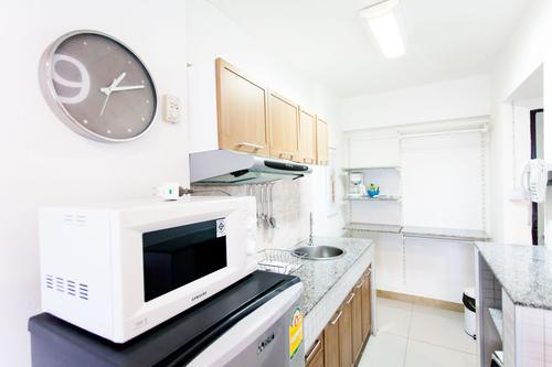 Fully equipped kitchen including a microwave