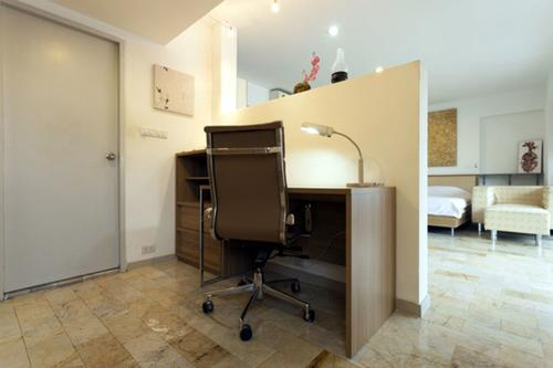Small private office area with an office chair