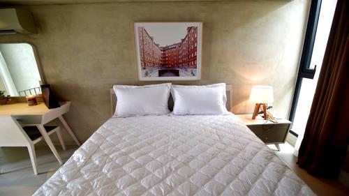 Large soft king-size bed with bedding sheet and pillows