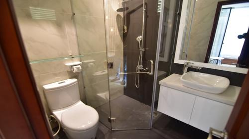 Bathroom with a toilet, shower and sink