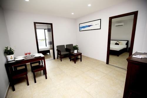 Fully furnished living area with a dining table, and a place to relax