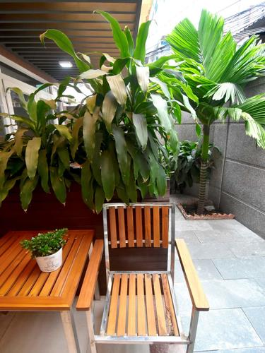 The outside terrace offers a small place to sit down and relax