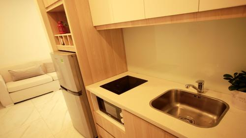 Fully equipped modern kitchen with fridge, microwave and electric stove