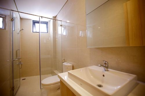 Spacious bathroom with a shower, and a large mirror