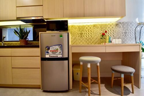 Small kitchenette with a fridge, and electric stove