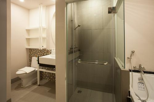 Large bathroom with a seperated toilet, and shower area