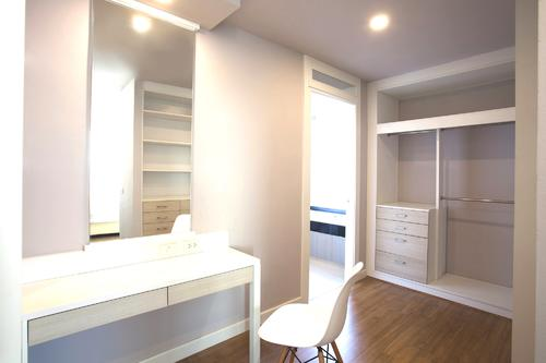 Large spacious walk-in closet including a work desk